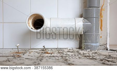 Close Up Drainage Pipe Of The Toilet, Reconstructing The Toilet