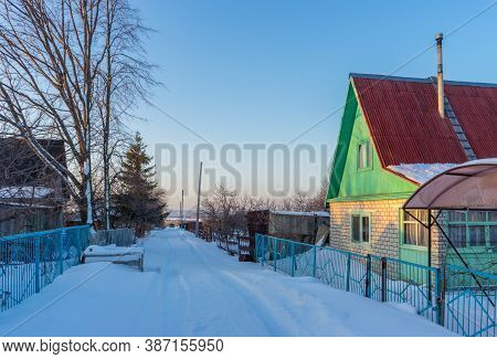 Street In Country Village Covered With Snow And Left For The Winter Brick Cottage House On Wintery E