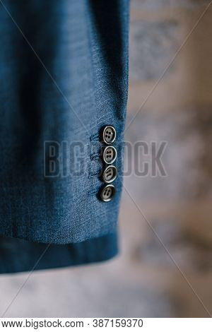 Close-up Of Buttons On The Sleeve Of A Mens Blue Jacket, Shallow Depth Of Field.
