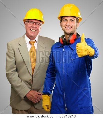 Two Architect Engineers On Gray Background