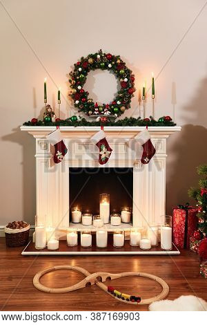 Christmas Fireplace With Santa Socks. Christmas Stocking Hanging From A Mantel Or Fireplace, Decorat