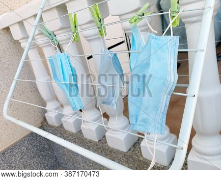Medical Masks Hanging Dry On Round Clothes Hanger,washing For Reuse,disinfecting Mask Using Sunlight