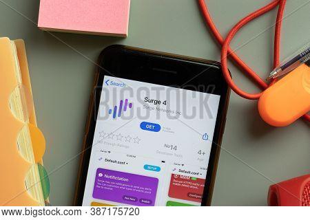 New York, Usa - 28 September 2020: Surge 4 Mobile App Logo On Phone Screen Close Up, Illustrative Ed