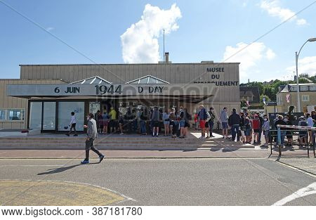 Normandy France, August 2020: Queues Outside The Musee De Debarquement Which Is A Museum Commemorati