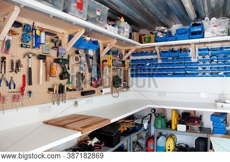 Great Britain, January 2011; A Workshop Area In A Home Garage With Organisation Of Tools And Diy Equ