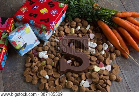 Dutch Candy Called Pepernoten Eaten During Sinterklaas Feast. Beside It Carrots For To The Horse Of