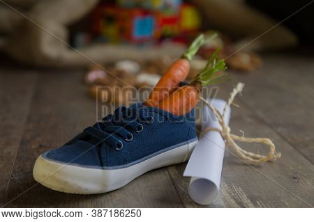 A Kid Places His Shoe With Carrots For Amerigo, The Horse Of Sinterklaas And A Drawing For Sinterkla