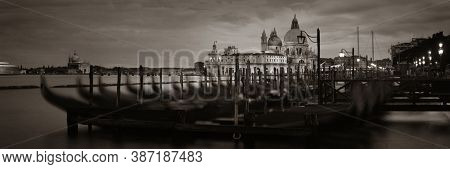 Venice  Church Santa Maria della Salute and gondola park at water front panorama view. Italy.