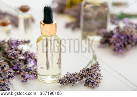 Lavender Essential Oil Glass Bottle Serum Dropper On White Wooden Rustic Table Fresh Lavender Flower