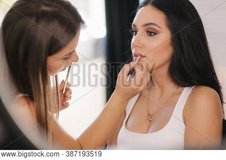 Makeup Artist Work In Her Beauty Studio. Portrait Of Woman Applying Makeup. Professional Make Up Mas