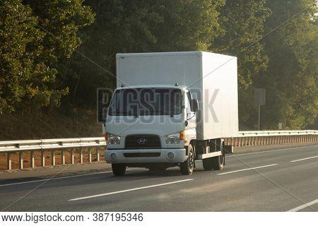 Truck driving on the asphalt road in summer rural landscape. Belgorod , Russia - SPT 23, 2020:
