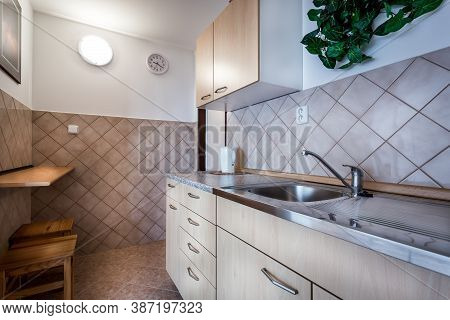 Kitchen At Home In Classic Style, Decorated In Beige With Wooden Fittings And With  Accessories And
