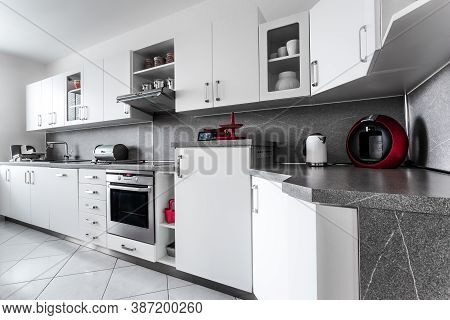 Kitchen At Home In Classic Style, Decorated In White With Marble Fittings And  With Numerous Accesso