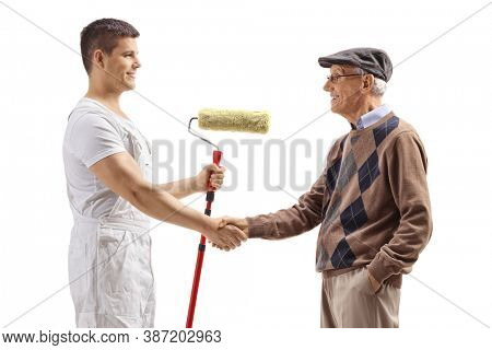 Painter with a roller shaking hands with a senior man isolated on white background