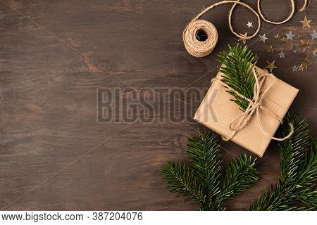 Christmas Background With Handmade Gifts Wrapping, Presents On Rustic Wooden Table. Christmas Or New
