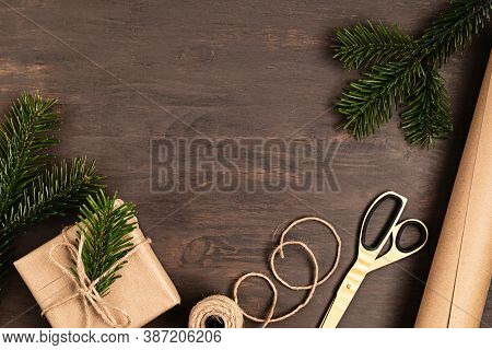 Christmas Background With Ifts Wrapping, Presents On Wooden Table. Christmas Diy Packing. Winter Hol