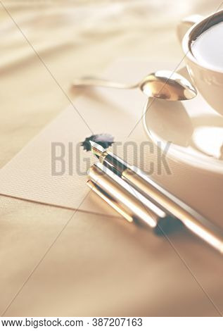 Cup of coffee and pen on blank paper sheet. Very shallow dof.  Copy space