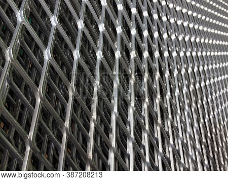Angle Of Constricted Of Metal Grille. Pattern Of Steel Grating. It Is A Framework Of Spaced Bars Tha