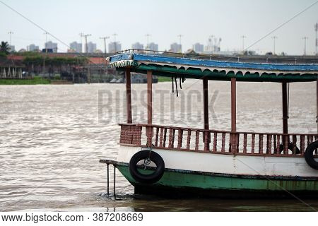 Wooden Ferryboat On Chaophraya River. A Boat For Conveying Passengers, Especially Over A Relatively