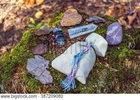 Magic Still Life With Fluorite, Quartz Crystal, Candle And Bag With Potion (herb). Rocks For Mystic