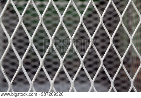 Square Diagonal Pattern Of Metal Cage. Pattern Of Steel Grating. It Is A Framework Of Spaced Bars Th