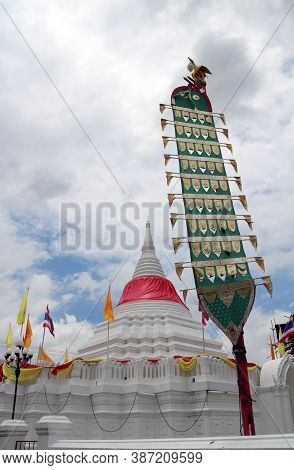 Centipede Flag And White Pagoda Has A Red Cloth Tied At The Top Surrounded By Thai National Flag, Ye