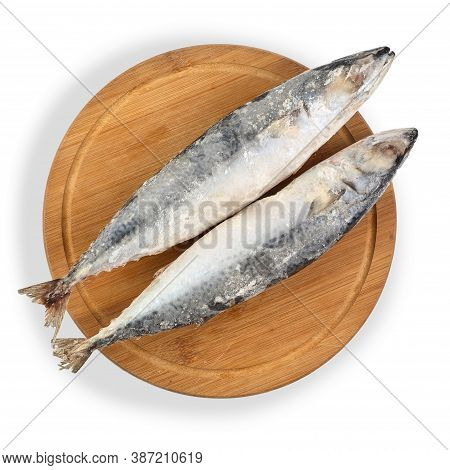 Frozen Mackerel Fish Isolated On White Background. Top View. Two Mackerels On The Board.