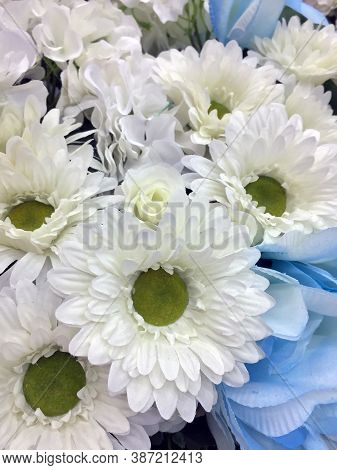 White And Light Blue Color Of Flower Bouquet, All Of It Made From Fabric. It Is An Attractively Arra