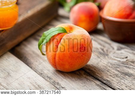 Peach Fruit With Leaf. Ripe Juicy Orange Peach Fruit Of Peach Tree On Wooden Cutting Rustic Board. P