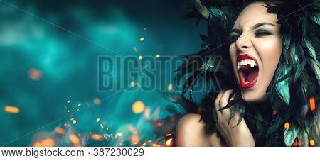 Young vampire woman portrait. Closeup