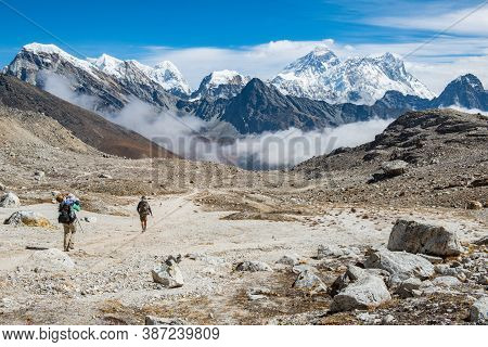 Tourist Trekking In Sagarmatha National Park With Beautiful View Of Mount Everest (8,848 M) The High