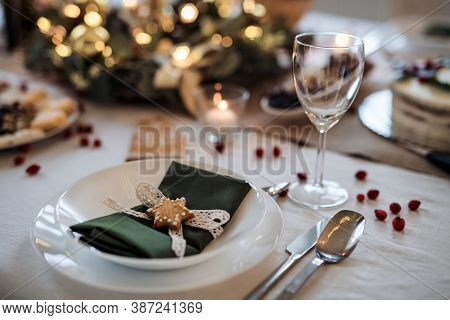 A Close-up Of Plate On Table Set For Dinner Meal At Christmas Time.