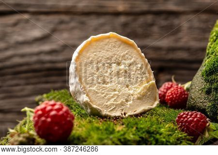 Camembert Or Brie Cheese With Raspberries, Gourmet Italian, French Cheese, The Concept Of Natural Ec