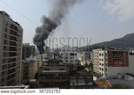 Rio, Brazil - September 28, 2020: Skyline In The City With Black Smoke From Bus Fire