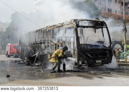 Rio, Brazil - September 28, 2020: Fire Brigade Fighting A Fire On Bus At City Street