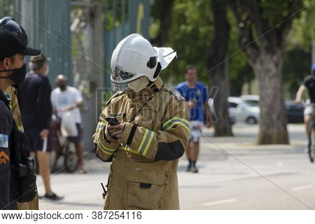 Rio, Brazil - September 28, 2020:fireman Man Makes Notes On His Cell Phone