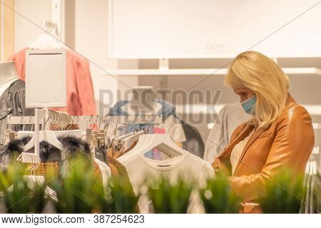 Vilnius, Lithuania - September 28 2020: Beautiful Blonde Hair Girl In A Shop With Mask, Shopping Dur