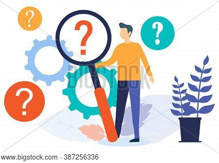 Finding The Information You Need. A Man Looks Through A Magnifying Glass At A Question Mark. Frequen