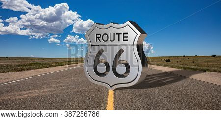 Route 66 Sign On The Road, Blue Sky Background. 3D Illustration