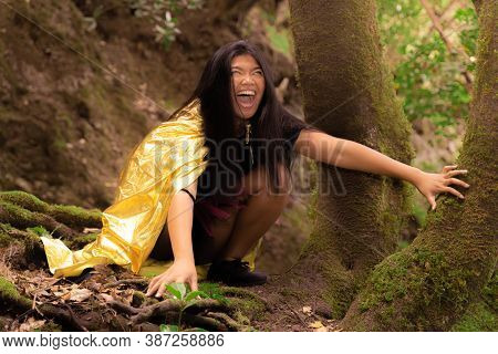 Terrifical Young Asian Woman In Witch Halloween Costumes. Halloween And Carnival Concept.