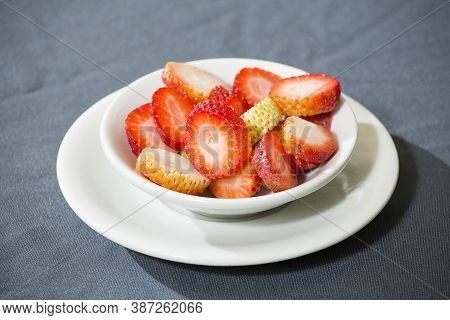 Sliced Strawberries On The Plate - Fragaria