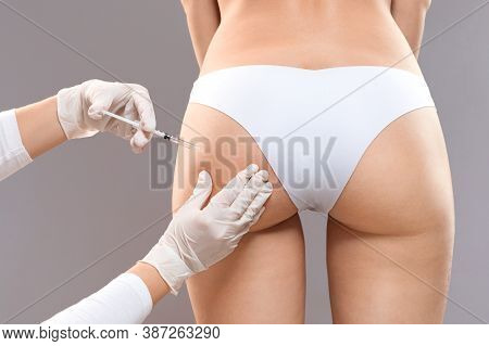 Sculptra Butt Lifting Concept. Slim Woman Having Hip Injection At Beauty Salon, Closeup. Plastic Sur