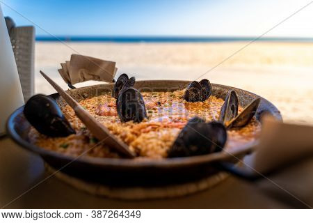 Seafood Paella In Seaside Restaurant Of Torredembarra, Tarragona, Spain
