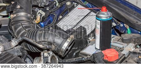 Automotive Engine Air Intake Tube, Filter And Can With Cleaning Liquid. Cleaning Process About To St