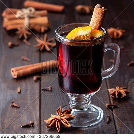 Red Glogg Or Mulled Wine With Orange Slices And Cinnamon Stick On A Dark Wooden Background, Square F