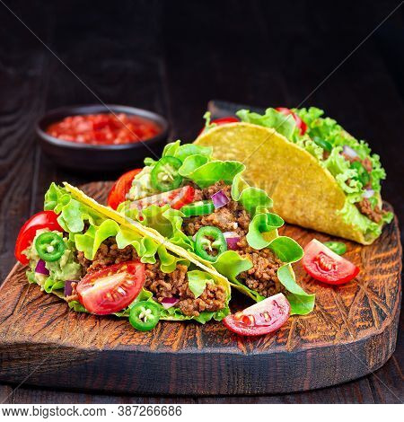 Taco With Ground Beef Meat,  Mashed Avocado, Tomato, Lettuce, Red Onion And Jalapeno Pepper, Square