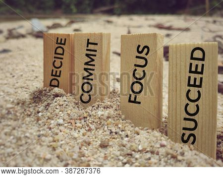 Decide Commit Focus Succeed Text On Wooden Blocks In Vintage Background. Inspirational And Motivatio
