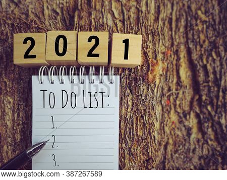 To Do List Text Written On Notepad In Vintage Background. Stock Photo.