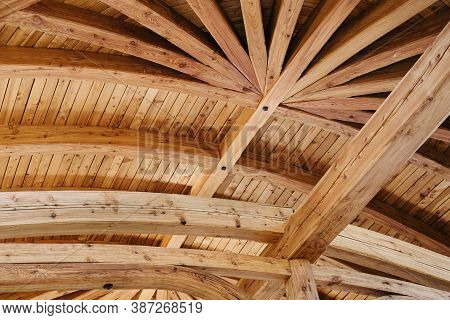 Part Of The Wooden Architecture Of The Building Interior. The Wood-paneled Ceiling With Wooden Beams