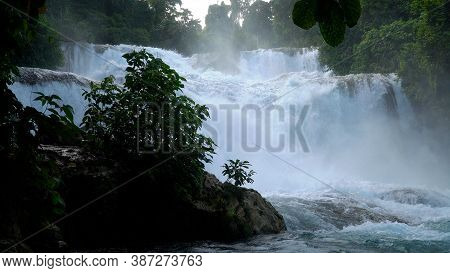 Cascade Of Aliwagwag Falls In Green Forest. Waterfall In The Tropical Mountain Jungle. Philippines,